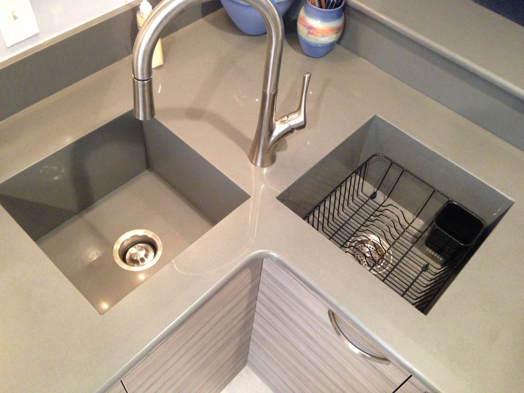 Quartz Stone Kitchen Sink : This Silestone quartz countertop features a set of integrated sinks.