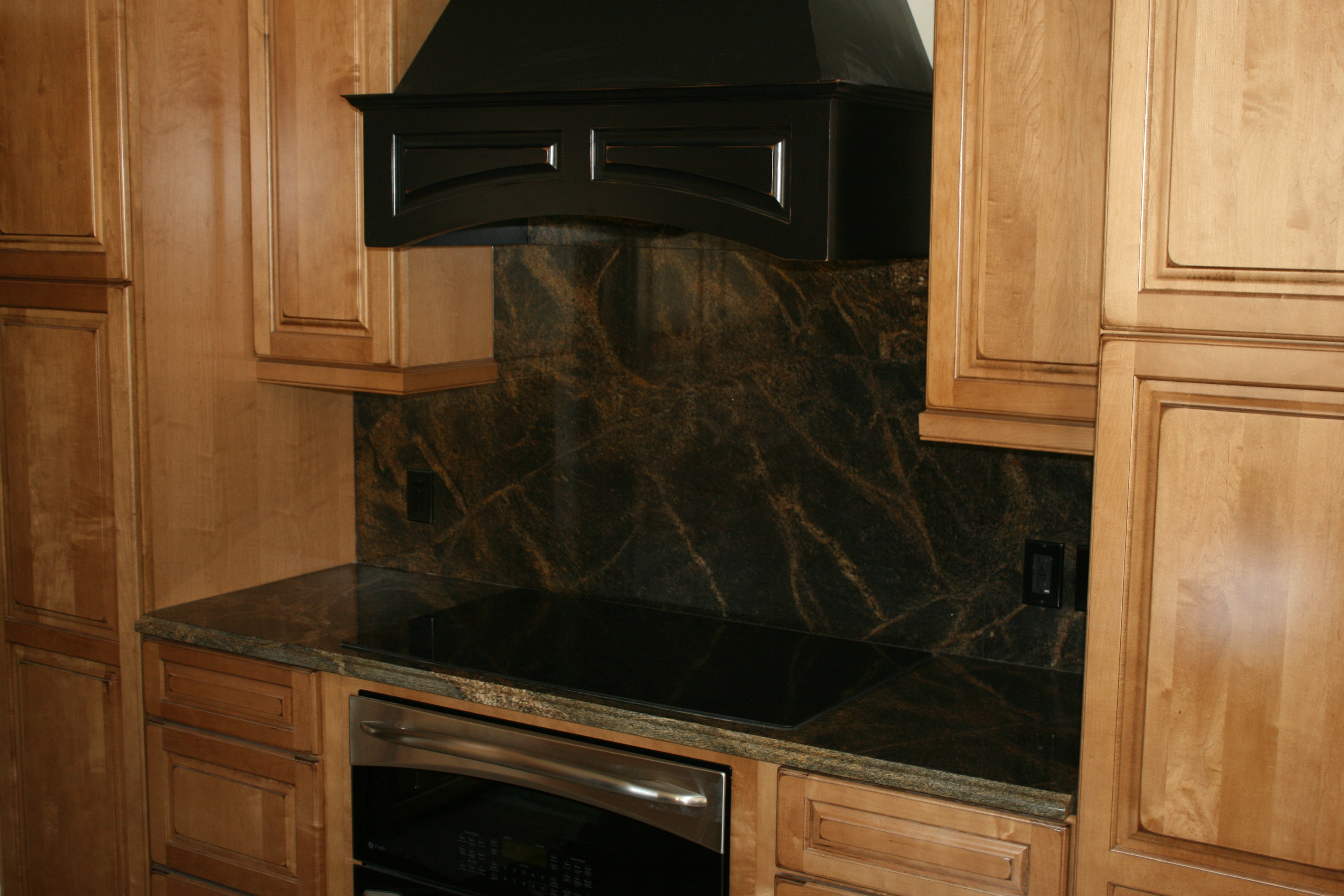 Rainforest Green Granite Countertop With Full Height Splash.